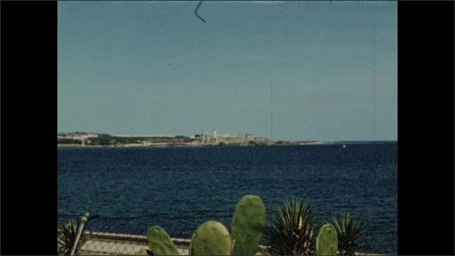 1940s: Buildings across the bay, along shore.