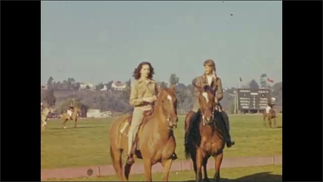 1940s: Horses tied to posts. Man standing up in convertible. Man in suit removes hat then puts hat back on. Two women riding horses, stop to pose. Two women ride horses.