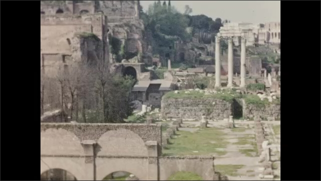 1940s: EUROPE: ITALY: stone work and walls at the Roman Forum at Palatine Hill. Visitors at ruins. Lady looks at camera.