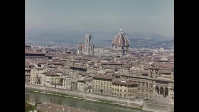 1940s: EUROPE: ITALY: scenery in Italy. View across city. River runs through city. Hills behind city. End of Reel Nr. 4