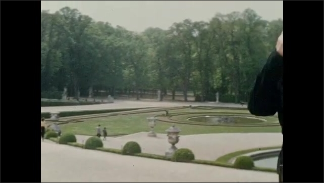 1940s: Woman poses in the gardens at Versailles.