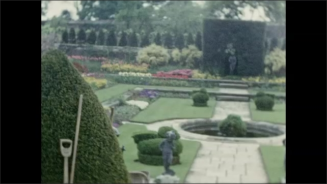1940s: EUROPE: FRANCE: walled gardens. Landscaped garden. Paths through garden. Flower beds