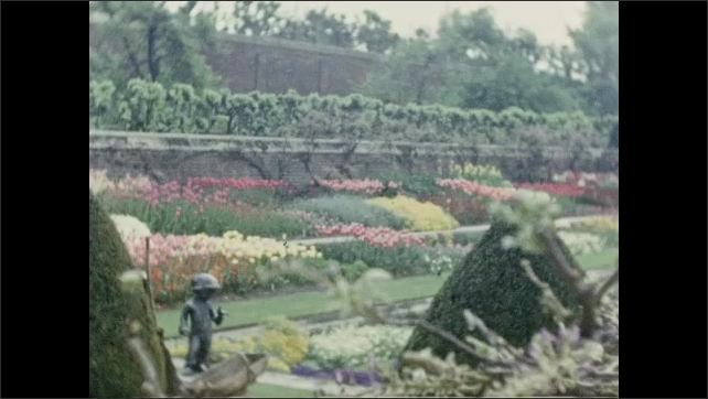 1940s: EUROPE: FRANCE: View across walled gardens at house. 16th and 17th century gardens at palace. Fountain in gardens.