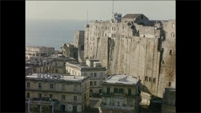 1940s: EUROPE: ITALY: Buildings in Naples. View to harbor in Naples. Defenses in Naples. View from balcony.