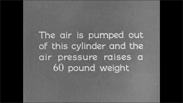 1930s: UNITED STATES: glass jar inside bell. Air is pumped out of cylinder. Increase in air pressure in container. Air pressure causes weight to lift up.
