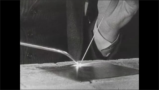 1940s: Hand holds steel rod while the other hand welds into a flat plate.