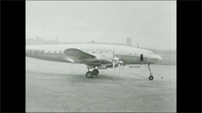 1950s: Commercial airplane taxis on runway. Jet plane goes down runway.