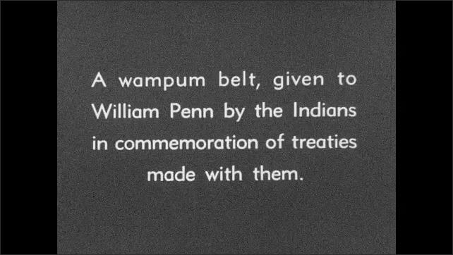 """1930s: Intertitle """"A wampum belt, given to William Penn by the Indians in commemoration of treaties made with them"""". A beaded wampum belt is unfolded."""