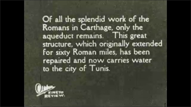 1930s: View of ancient statues. Intertitle. View of ruins. Intertitle.