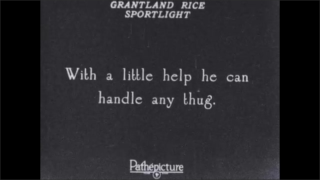 1930s: Dog leaps from shed roof into arms of man. Text placard. Man helps boy into bite-proof jacket.