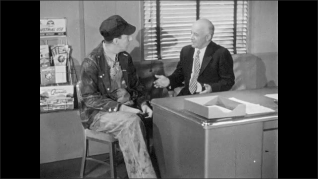 1960s: UNITED STATES: men sit at desk. Man in suit talks to farmer. Man laughs. Man pulls papers from drawer.