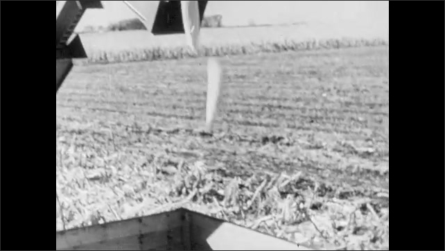 1960s: UNITED STATES: lady cleans fridge. Girl looks at new bike. Man harvests corn on tractor. Corn on elevator. Corn falls into drying building
