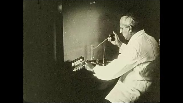 1930s: woman uses glassware in laboratory. title card reads, armies of health. man unloads pipette into flask. hands pour test tube into can and drops down top. women work with tubes on bench.