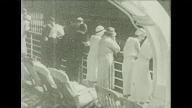 Bermuda 1930s: People stand at railing of ship. Intertitle card. People wave.