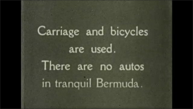Bermuda 1930s: Intertitle card. Monument. People ride bicycles, travel in horse drawn carriage.