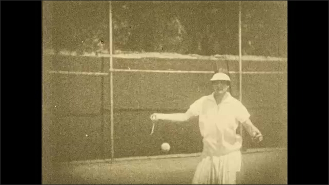 1930s: Still frames, woman on tennis court hits ball with forehand stroke.
