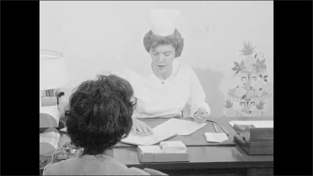 1960s: UNITED STATES: lady gives form to nurse at desk. Nurse looks at form. Lady gives blister pack of tablets to nurse. Nurse takes birth control tablets from patient