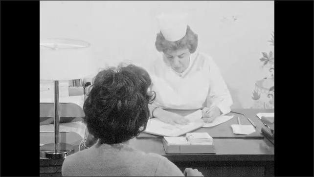 1960s: UNITED STATES: nurse interviews lady about birth control. Nurse fills in form. Nurse asks question during consultation.