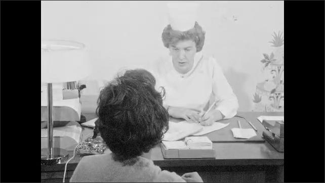 1960s: UNITED STATES: nurse smiles at patient. Lady laughs nervously. Nurse asks patient medical questions
