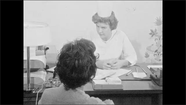 1960s: UNITED STATES: nurse explains concept to patient. Lady visits nurse