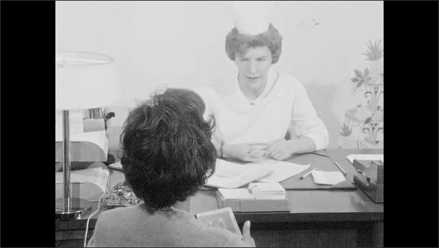 1960s: UNITED STATES: nurse nods head. Nurse shakes head. Patient listens to nurse