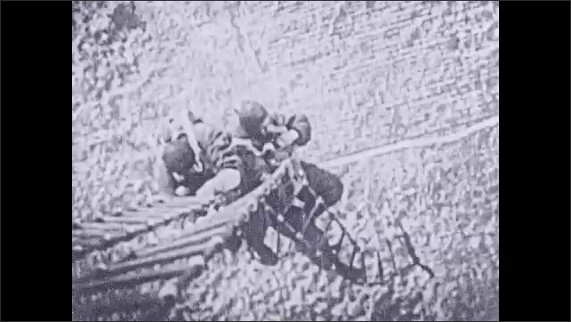 1930s: Men hold onto ladders suspended from plane, let go of ladder, deploy parachutes.