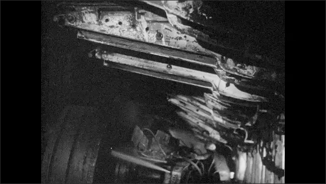 1960s: Immediate Forward Support (IFS) is secured to ceiling of tunnel. Man assists drilling machine in tunnel as IFS machines are moved to secure ceiling behind them.