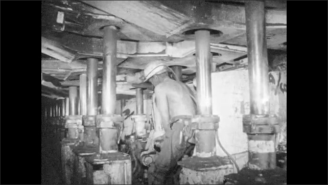 1960s: Man uses hydraulics to move and lift Immediate Forward Support (IFS) machine to secure ceiling in tunnel.