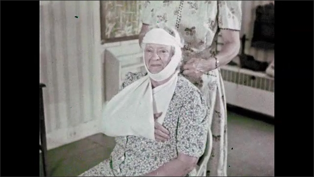 1960s: Man greets woman outside building, enters building. Man walks into room. Woman putting bandages on other woman.  Nurse watches women bandage other women.