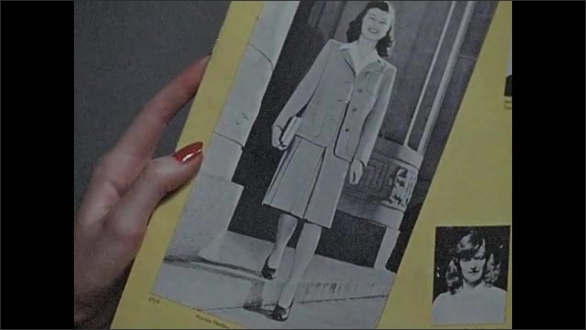 """1940s: Hand holds catalog titled """"BUTTERICK SCHOOL FASHIONS.""""  Woman compares fabric to sketches on wall."""