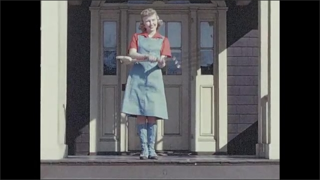1940s: Photo of model in magazine.  Girl comes out of house carrying pitchfork.  Girl puts tool over shoulder and walks away.