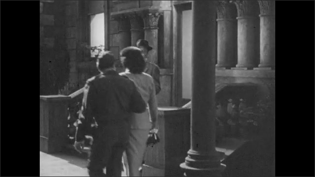 1950s: Woman leaves room, man closes door, smiles and raises eyebrows. Man exits building at night, accidently bumps into other man on sidewalk.