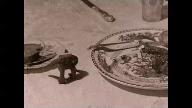 1930s: Lettuce with arms and duck shaped salt shaker talk on table. Stick of butter with arms and legs moves fork on plate then slides knife to Duck and Lettuce.