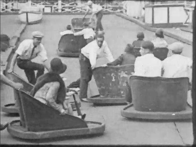 CONEY ISLAND 1920s: Couple on wavy cart ride. Words describe sheet steel sea. Woman on ride. Words again describe ride. People on ride.