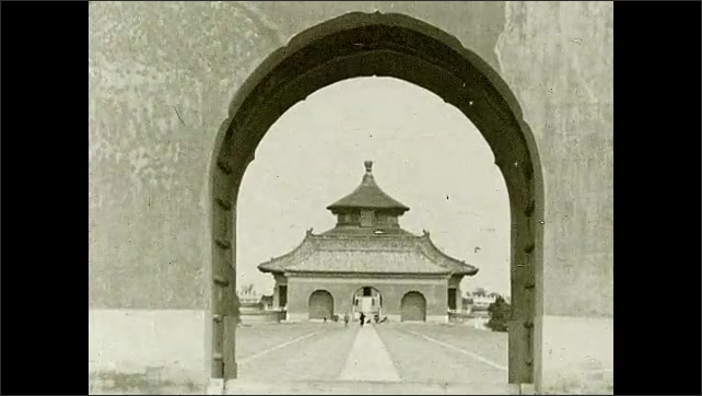 1930s: Man pulls rickshaw past statue of lion. Intertitle card. Entrance to Temple of Heaven. Steps lead up to the Hall of Prayer for Good Harvests.