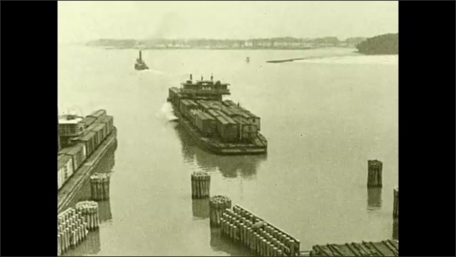 1930s: Map of Chesapeake Bay with arrow going from Fort Monroe to New York. Barge with train cars loaded on it leaves dock and heads to bay. Arrow on map points to Cape Henry. Title card.
