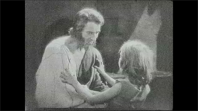 1930s: Boy and Jesus hug and talk, boy looks at his own hand. Jesus holds onto boy, boy stands up.