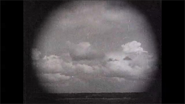 1930s: UNITED STATES: the every day cloud of the prairie country title. Clouds over prairies. Often looming into a thunderhead title. Thunderclouds in sky