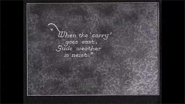 1930s: UNITED STATES: clouds move above house. 'when the carry goes east, gude weather is neist' title.
