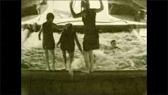 1930s: PACIFIC OCEAN: passengers enjoy pool on deck of ship. Children jump in water