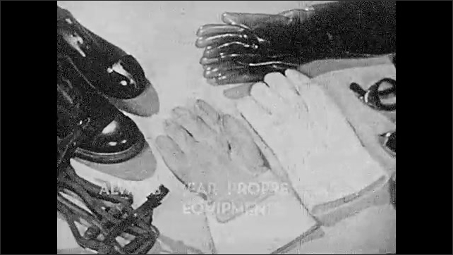 """1930s: Subtitle """"Always wear proper safety equipment"""" over safety equipments. Respirators, welding helmet, goggles, safety gloves, steel-toed shoes and safety harness."""