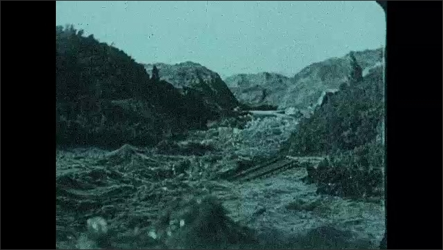 1930s: UNITED STATES: destruction caused by flash flood. Bridge and damage to homes in flood. Dam bursts in flood.