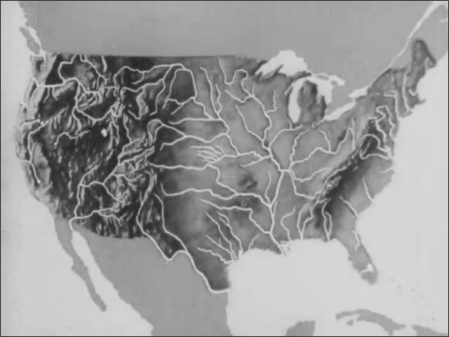 1930s: Animation of topographical map of the continental United States of America, arrow points to mountain ranges.