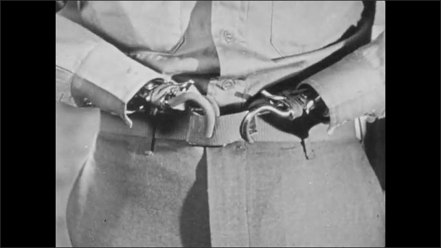 1940s: Man brushes teeth.  Double amputee uses hooks to fasten belt.