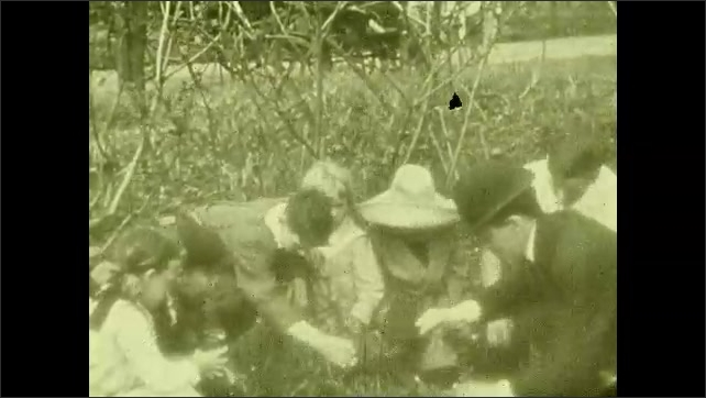 1930s: UNITED STATES: children clean up rubbish outdoors. Swamp drainage