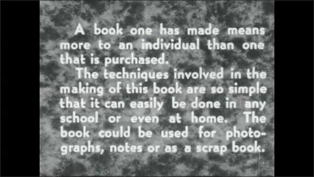 1930s: Title placard. Stack of books on table. Book stands open on table.