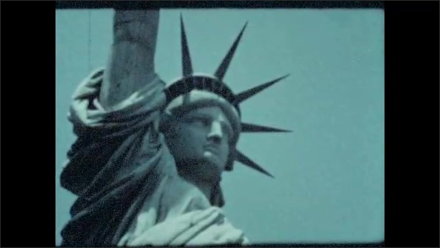 1940s: UNITED STATES: Statue of Liberty. Close up of Statue of Liberty. Torch on statue. Buildings and factories