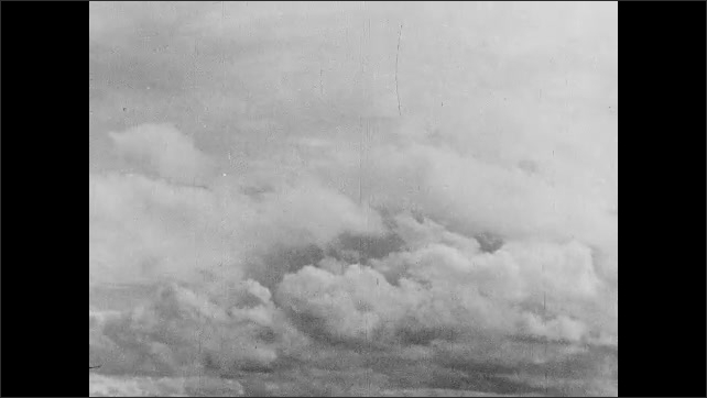 1930s: UNITED STATES: close up of man's face. Clouds and sky.
