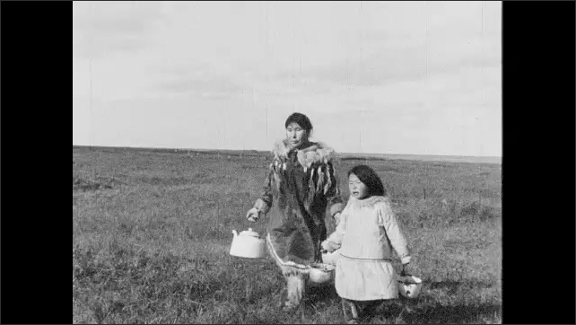 1930s: UNITED STATES: girl and mother collect fresh water from tundra. Girl visits friend. Sick child. Girl gives water to friend