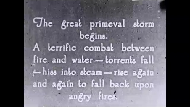 1930s: Jets of water. Intertitle ????he great primeval storm begins. A terrific combat between fire and water ?????torrents fall ?????hiss into steam...???? Rain fall over flames.